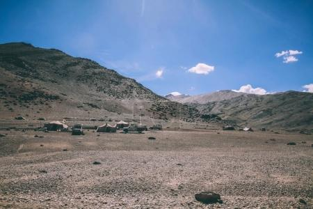mountain camp with cars and tents in Indian Himalayas, Ladakh region
