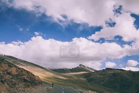 motorcyclist on mountain road in Indian Himalayas, Ladakh region