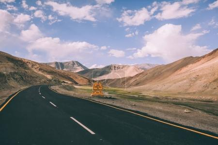 Photo for Asphalt road with traffic sign in Indian Himalayas, Ladakh region - Royalty Free Image