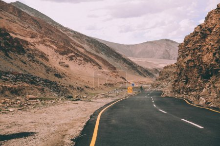 Photo for Asphalt road with traffic signs in Indian Himalayas, Ladakh region - Royalty Free Image