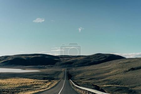 Photo for Empty asphalt road between scenic hills in Iceland - Royalty Free Image