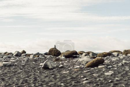 beautiful landscape with rocks and cloudy sky in Iceland