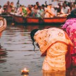 People perform ritual puja at dawn in the Ganges R...