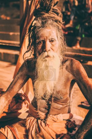 Sadhu man with traditional painted face and body in Varanasi, India