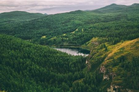 majestic mountains covered with trees and beautiful mountain lake in Altai, Russia