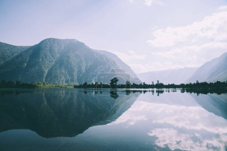 Photo for Majestic mountains reflected in calm mountain lake in Altai, Russia - Royalty Free Image