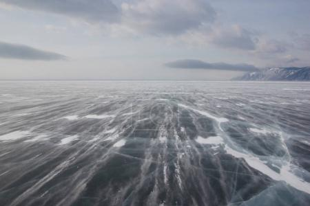 Photo for View of ice water surface under cloudy sky during daytime, russia, lake baikal - Royalty Free Image
