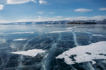 view of ice covered lake water and hills on background, Russia, Lake Baikal