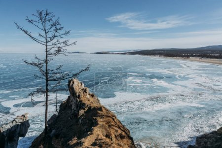 stone structure on foreground and wavy sea water on background, Russia, Lake Baikal