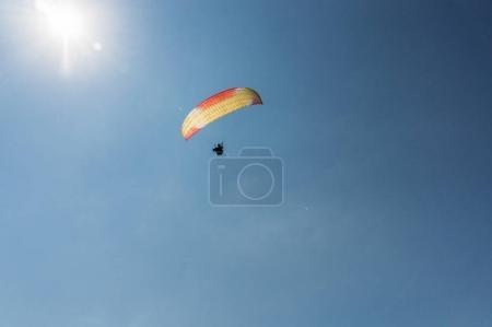 Parachutist flying in blue clear sky, Crimea, Ukraine, May 2013