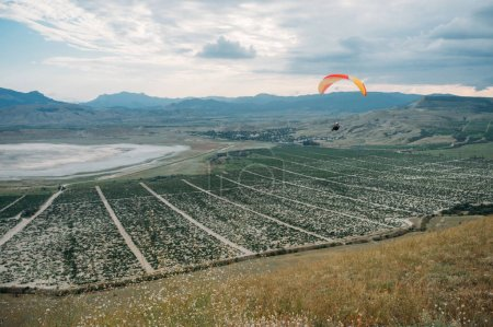 Parachute in the sky over field in hillside area of Crimea, Ukraine, May 2013