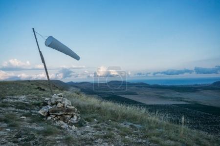 Beautiful mountainous landscape with windsock waving in Crimea, Ukraine, May 2013