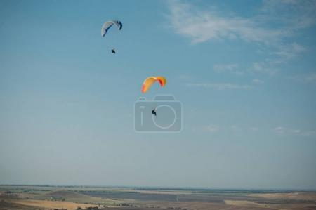 Parachutes in the sky over field in hillside area of Crimea, Ukraine, May 2013