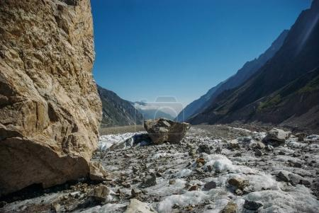 amazing snowy valley between mountains, Russian Federation, Caucasus, July 2012