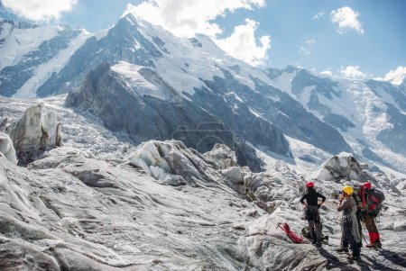 hikers standing and looking at beautiful mountains, Russian Federation, Caucasus, July 2012