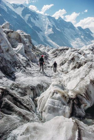 hikers going on rocky path, Russian Federation, Caucasus, July 2012