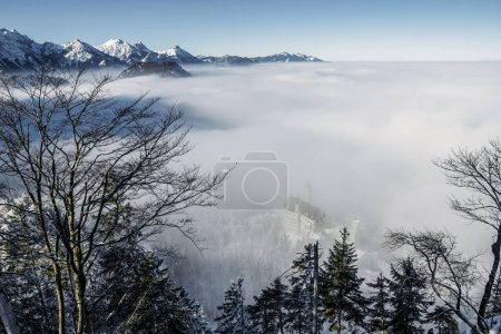Photo for Scenic view of snowy mountains in fog near Neuschwanstein Castle, Germany - Royalty Free Image