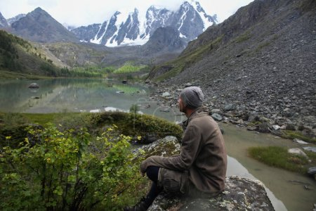 Side view of tourist resting in Himalayas mountains, Altai, Russia