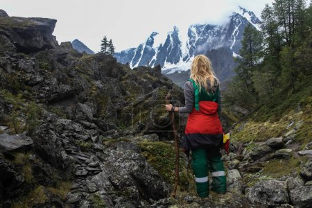 Photo for Back view of woman standing in mountains, Altai, Russia - Royalty Free Image