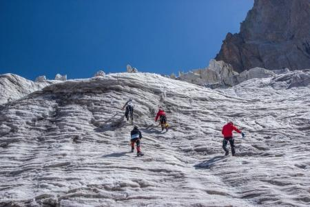 Photo for Back view of hikers climbing at beautiful snow capped mountains, kyrgyzstan, ala archa - Royalty Free Image