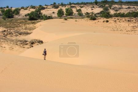 Photo for Back view of lonely person standing in desert, Vietnam, Phan Thiet - Royalty Free Image