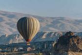 Hot air balloon flying in Goreme national park, fairy chimneys, Cappadocia, Turkey
