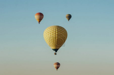 Photo for Hot air balloons flying in blue sky - Royalty Free Image