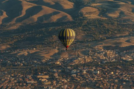 aerial view of hot air balloon over fairy chimneys, Cappadocia, Turkey