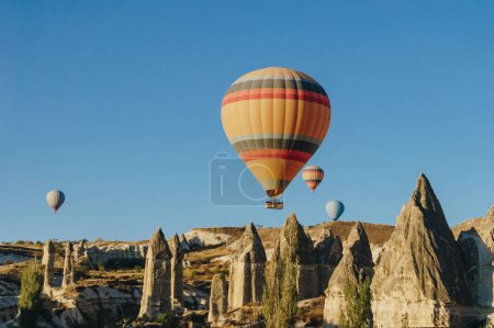 Hot air balloons flying in Goreme national park, fairy chimneys, Cappadocia, Turkey