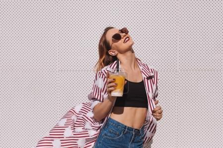 sensual young woman with mango shake in plastic cup