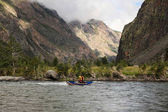 people on kayaks rafting on mountain river and beautiful landscape, Altai, Russia