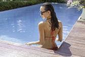 sensual young woman in bikini at swimming pool