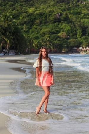 beautiful young girl posing on beach at tropical resort
