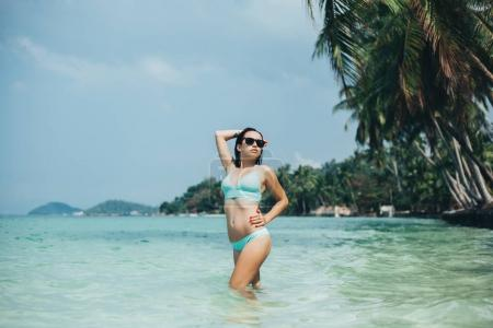 Photo for Beautiful girl in swimsuit at tropical sea resort - Royalty Free Image