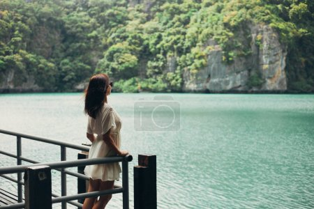 Photo for Side view of woman standing on pier near bay at Ang Thong National Park, Ko Samui, Thailand - Royalty Free Image