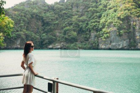 Photo for Attractive woman looking at bay at Ang Thong National Park, Ko Samui, Thailand - Royalty Free Image