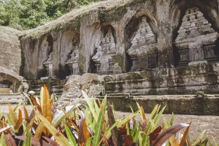 scenic view of ancient architecture of Temple Complex and Royal Tombs and plants around, Bali, Indonesia