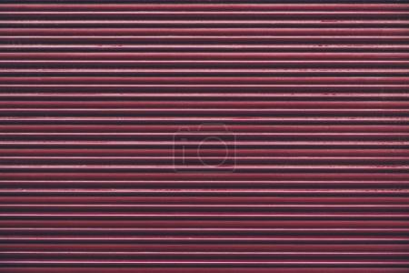 red horizontally striped wall for background