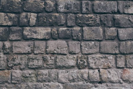 close-up shot of black aged brick wall for background
