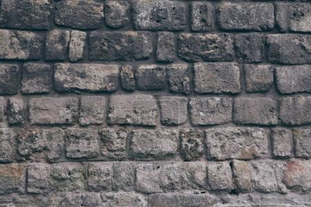 Photo pour Gros plan du mur de briques noires vieilli pour l'arrière-plan - image libre de droit