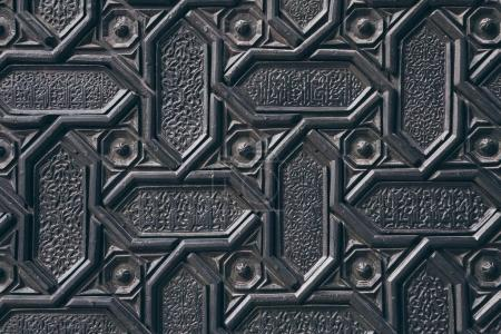 Photo for Close-up shot of black wall with carved arabesque pattern - Royalty Free Image