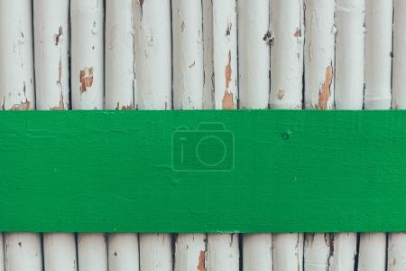 wooden logs painted in white for background