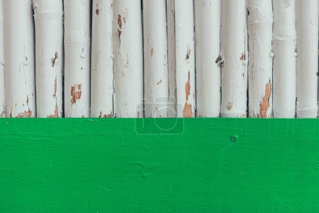 grungy wooden logs painted in white for background