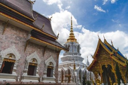 building of beautiful thai temple on sunny day