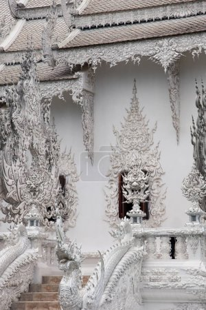 beautiful thai temple decorated with sculpture flames