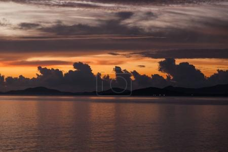 Photo for Tranquil cloudy sunset sky over sea surface - Royalty Free Image