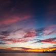 Colorful sunset sky over tranquil sea surface...