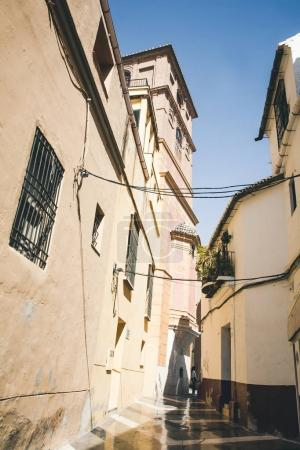 low angle view of narrow street, spain