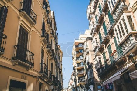 low angle view of buildings on street, spain