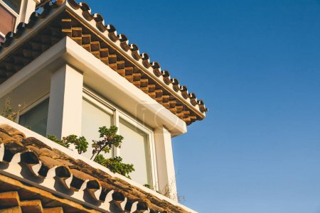 roof of spanish house under blue sky
